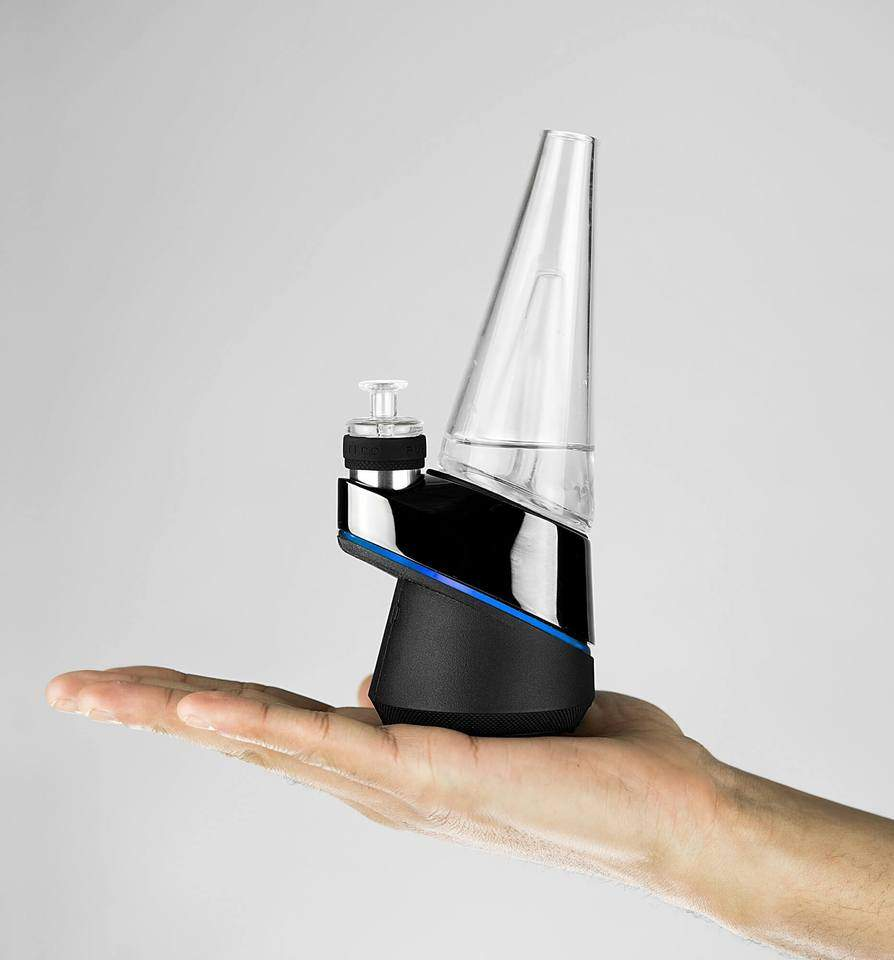 puffco peak smart vaporizer held in hand